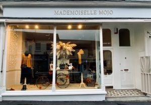 The front window of Mademoiselle Mojo shop with an autumnal display